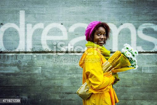 istock Young woman following her dreams 471921239