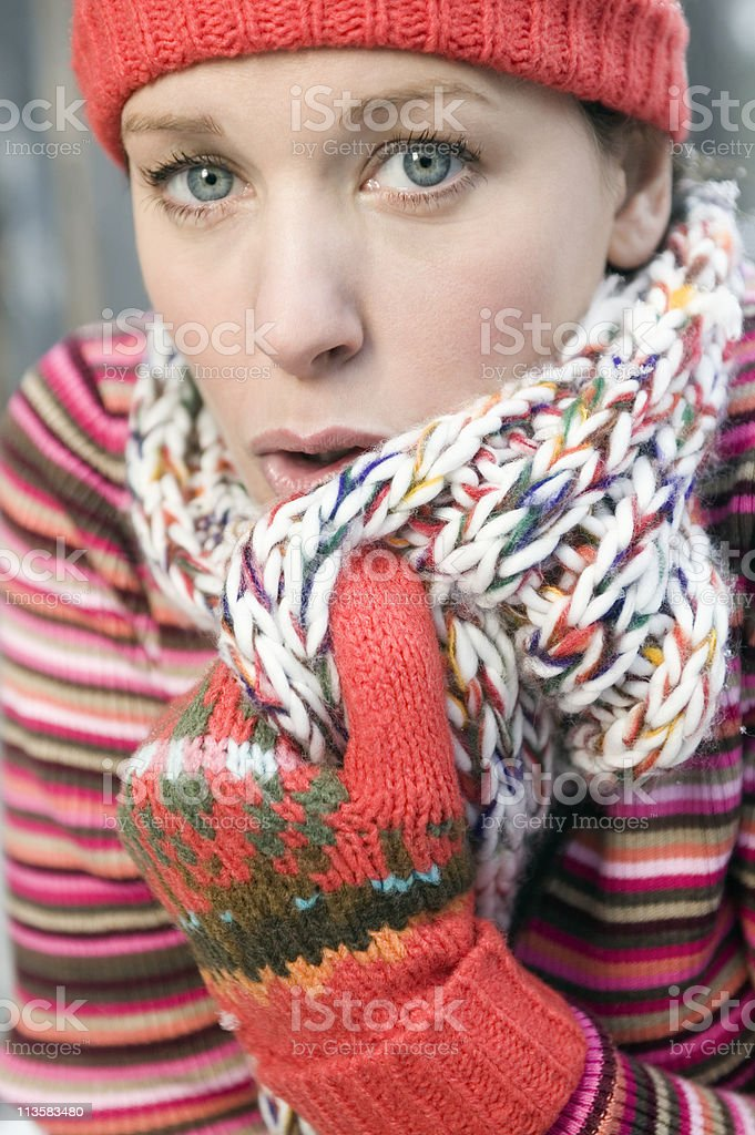 young woman freezing stock photo