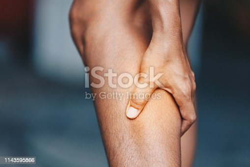 istock young woman from calf pain, Health care concept 1143595866
