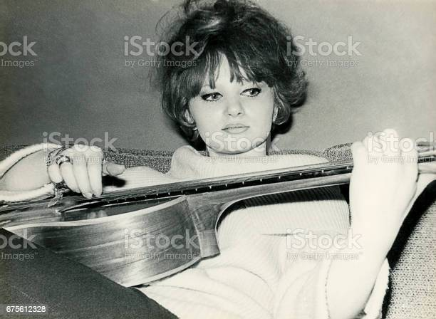 Young woman from the sixties playing guitar picture id675612328?b=1&k=6&m=675612328&s=612x612&h=sx5bsbemnfbeeles13hx796ppkypl6b nkcj3cn0av8=