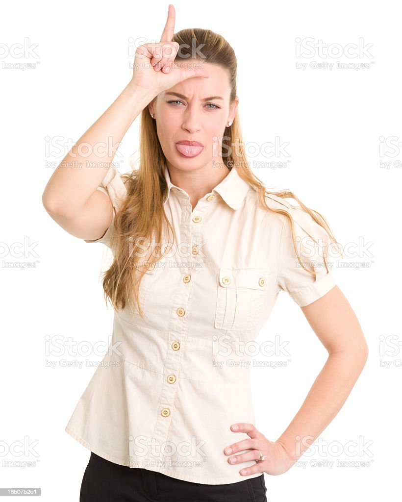 Young Woman Gestures Loser L And Sticks Out Tongue royalty-free stock photo