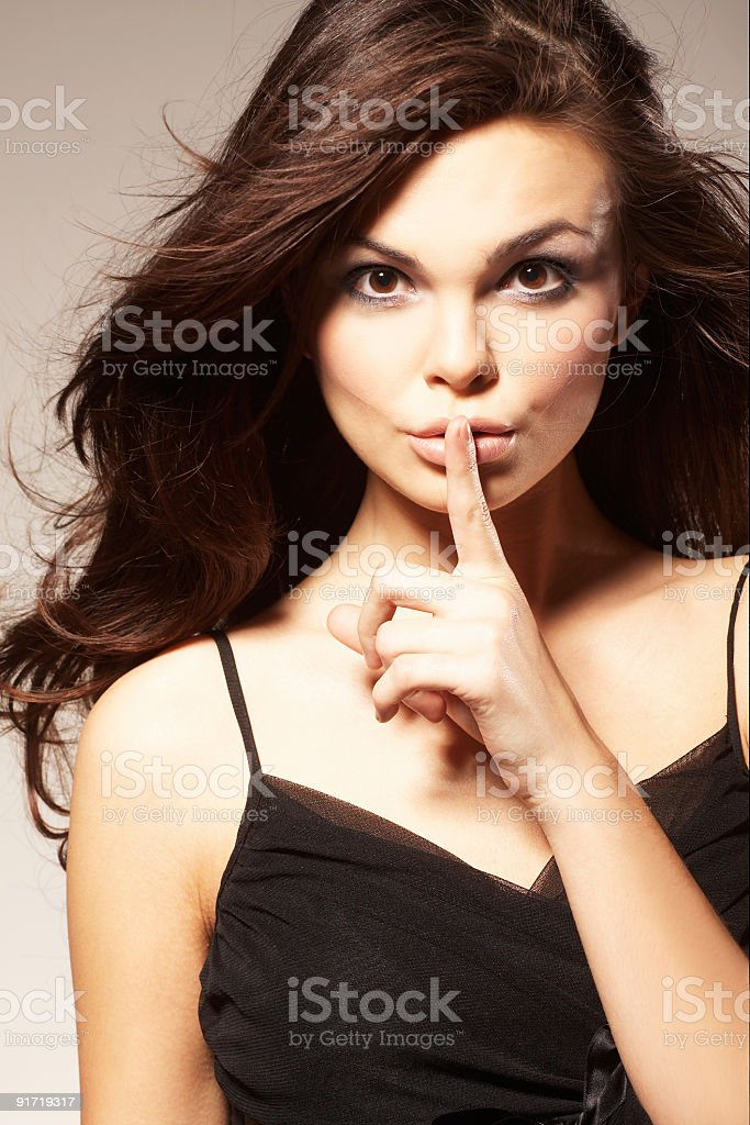 Young Woman Gesturing for Quiet or Shushing royalty-free stock photo
