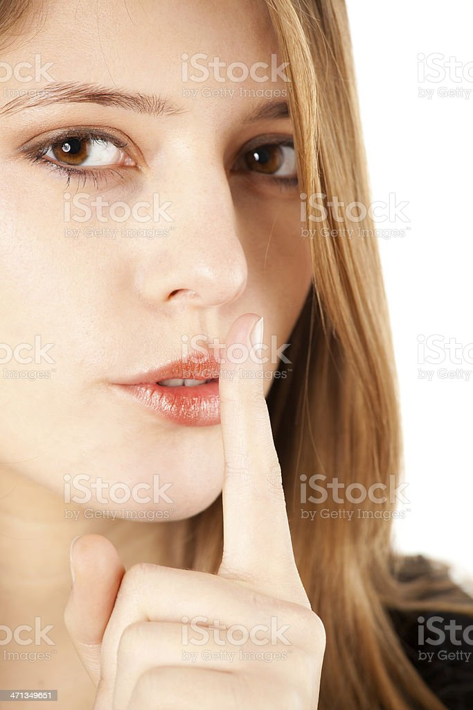 Young woman gesturing shushing royalty-free stock photo