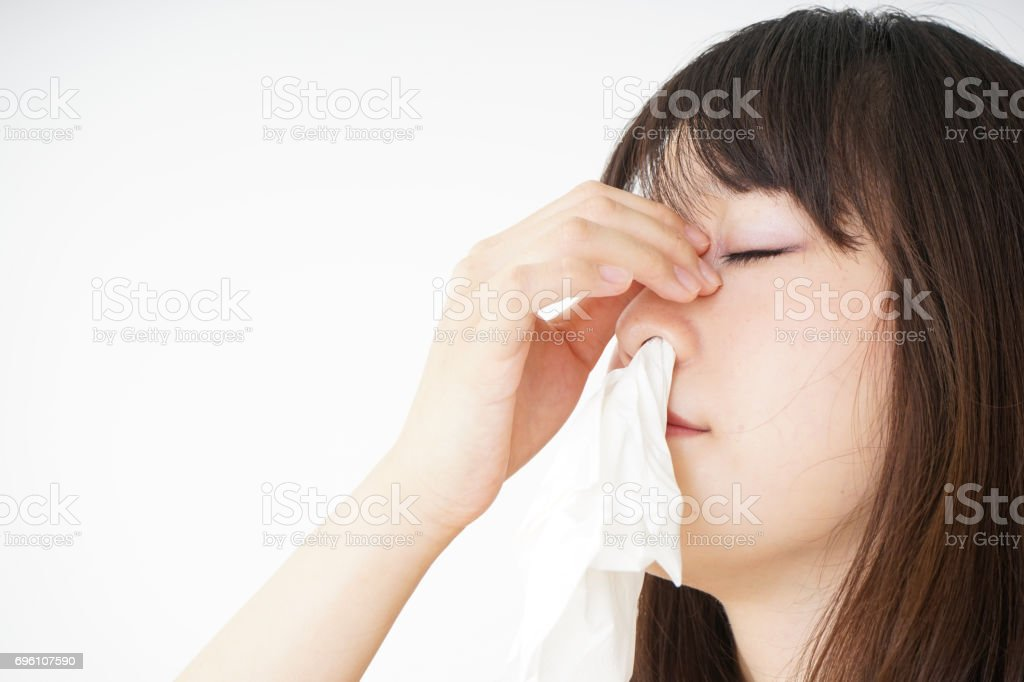 Young woman getting a bloody nose stock photo