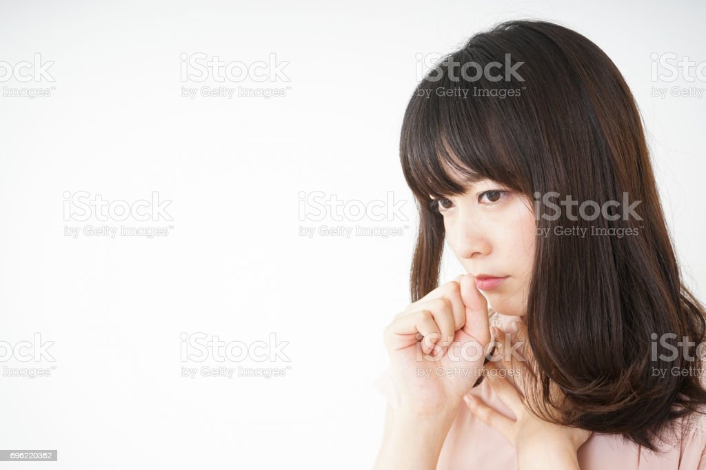 Young woman getting a cough because of stock photo