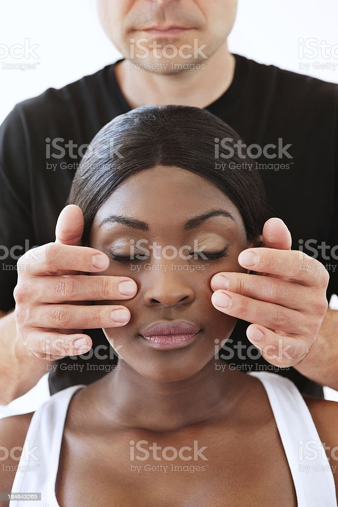 Young Woman Getting a Face Massage royalty-free stock photo
