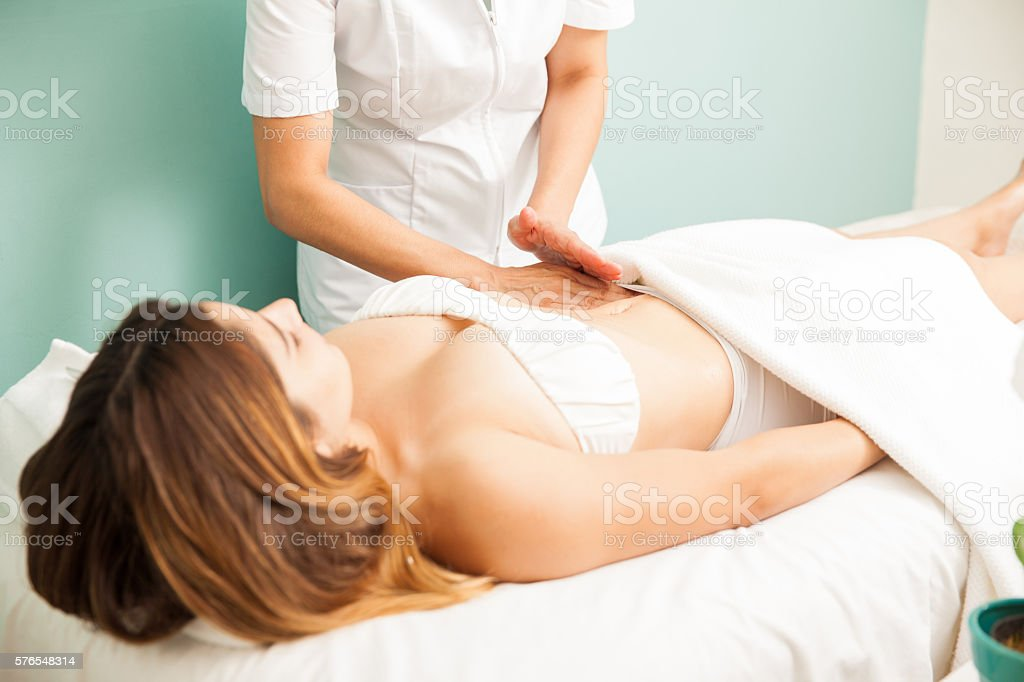 Young woman getting a lymphatic massage stock photo