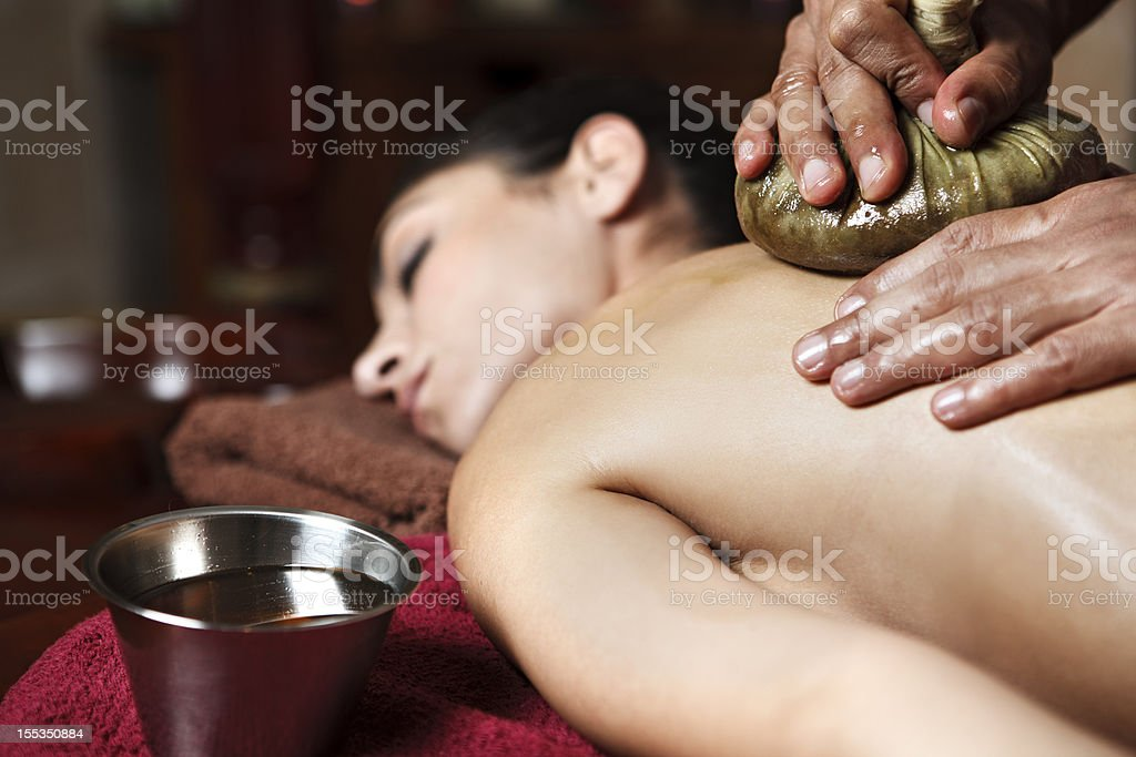 Young woman getting a navarakizhi massage stock photo