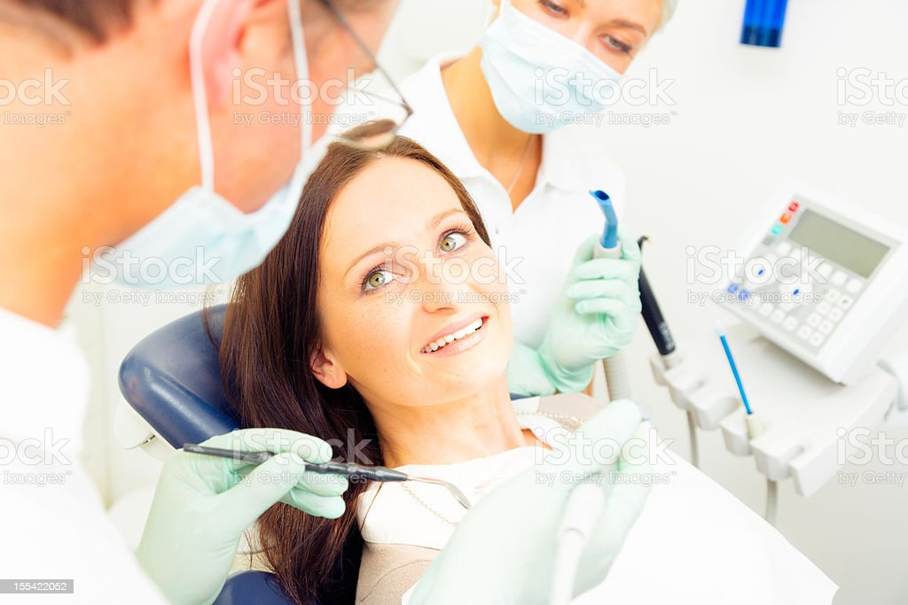 young woman getting a treatment at the dentist royalty-free stock photo