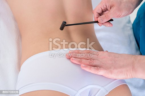 istock young woman getting anticellulite and anti fat therapy in beauty salon,  Su Jok instrument 859703026