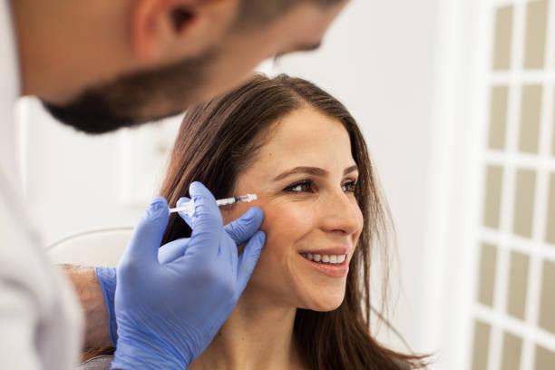 Young Woman Getting Botox Injectio stock photo