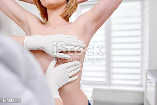 istock Young woman getting breast examination at the hospital 842882114