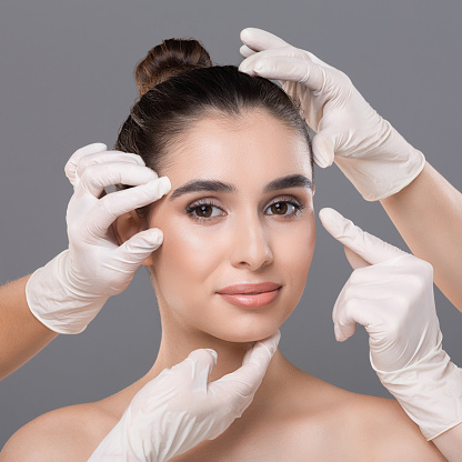 istock Young woman getting consultation at plastic surgery clinic 1159988092