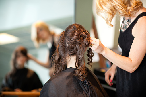 Young Woman Getting Hair Styled As Updo In Salon Stock Photo - Download Image Now