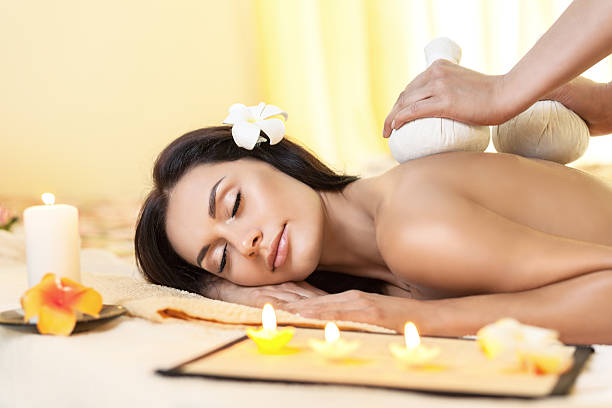 Young woman getting massage in Thai spa. stock photo