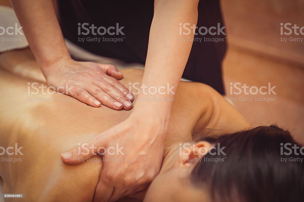 Young woman getting professional massage stock photo