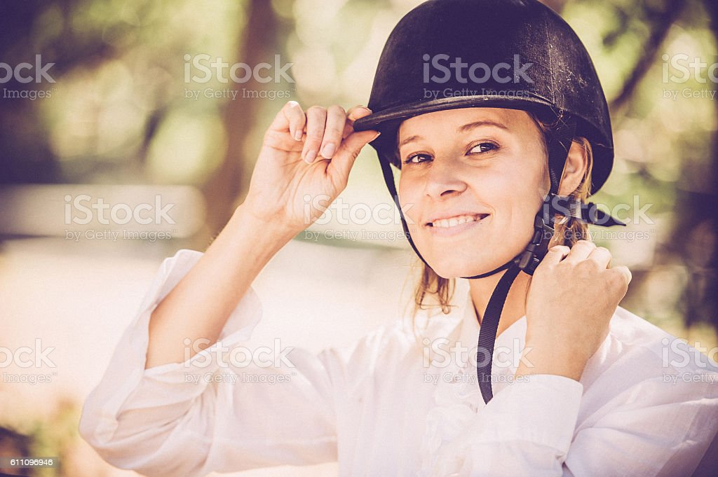 Young Woman Getting Read for a Horseriding stock photo