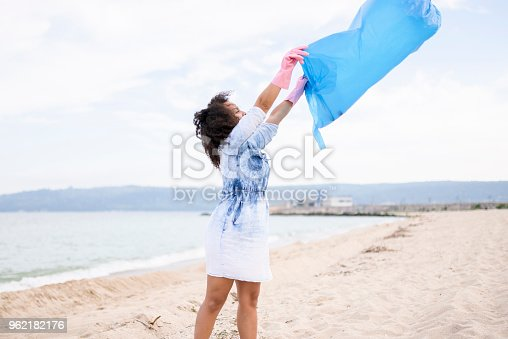 962184460 istock photo Young woman getting ready for local clean up 962182176