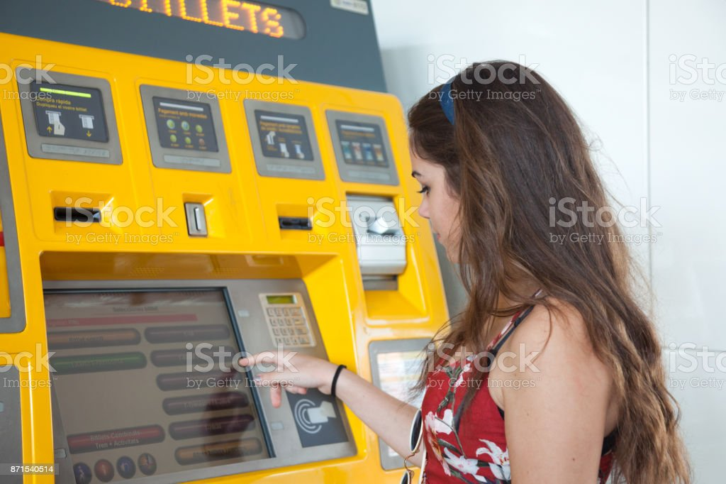 Young woman getting traintickets stock photo