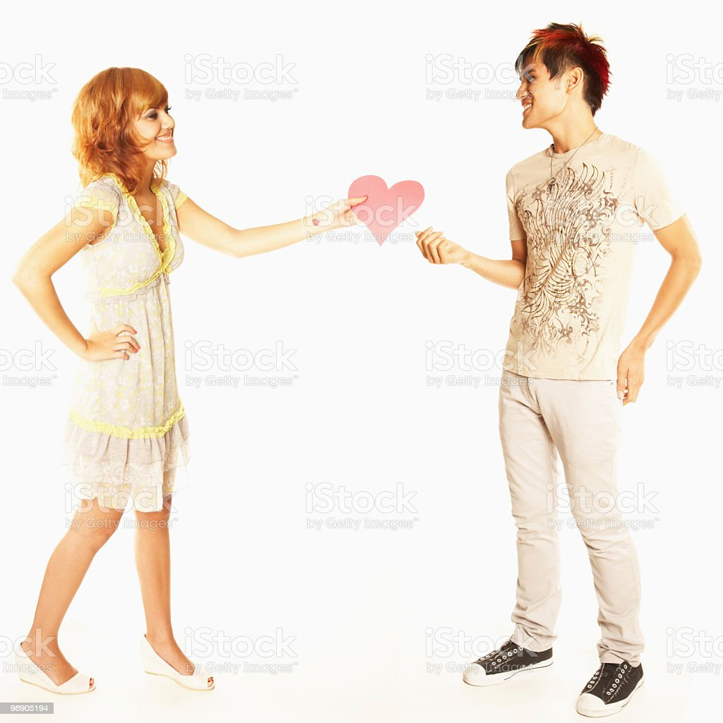 Young Woman Gives Heart to Her Valentine. Isolated royalty-free stock photo