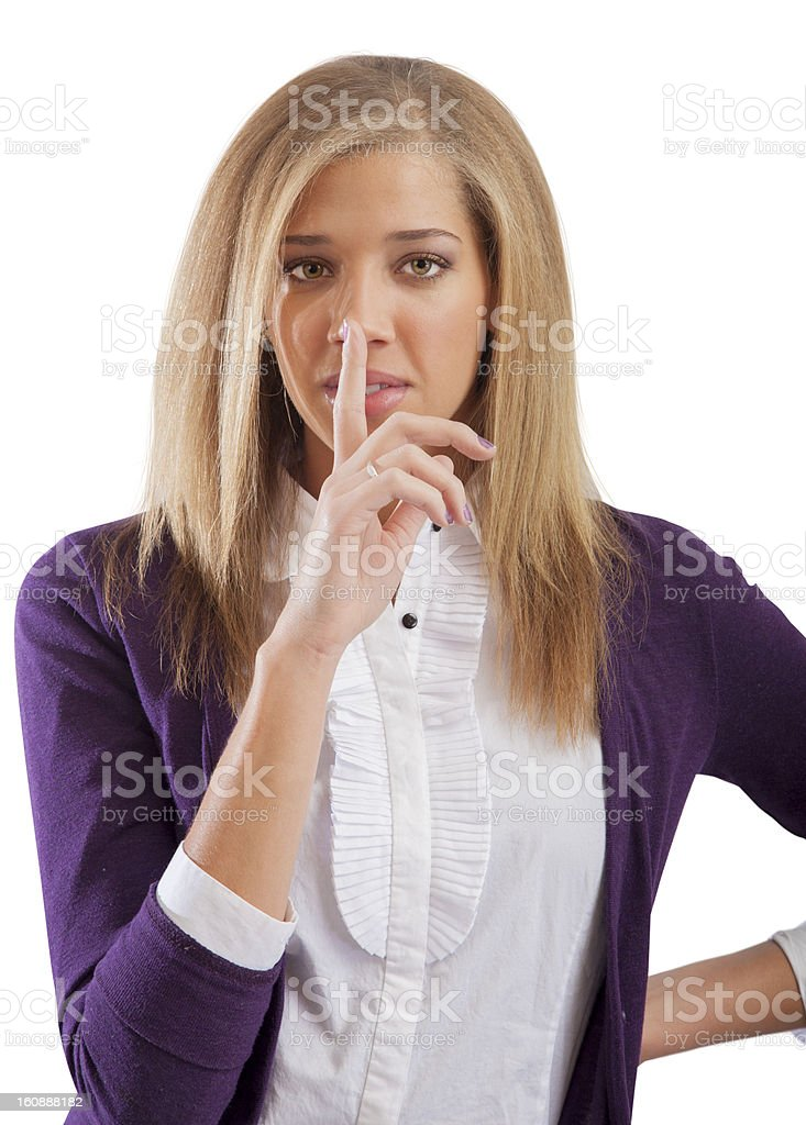 Young woman gives the be quite sign royalty-free stock photo