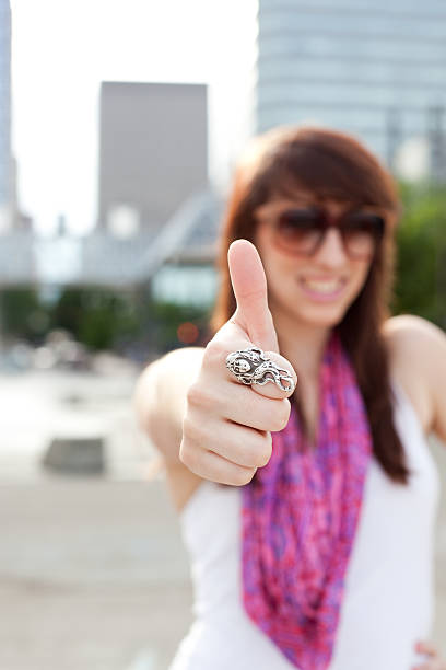 Young Woman Giving a Thumbs Up stock photo