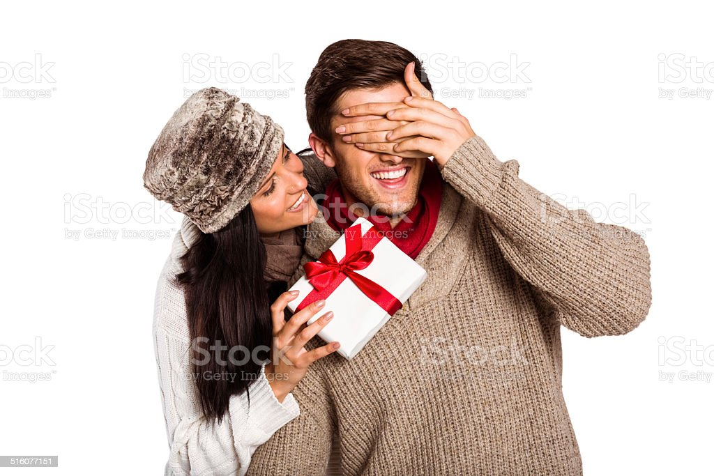 Young woman giving gift to boyfriend stock photo