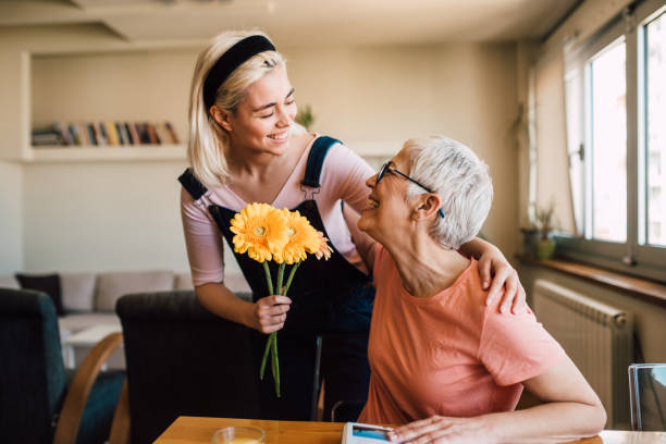 Young woman giving her mother flowers picture id1165406386?b=1&k=6&m=1165406386&s=612x612&w=0&h=snnejget5k z7xdenbyfcjeodj28yamuvhha6 frhpk=