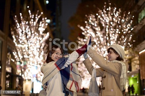 istock Young woman giving high five 1126583142