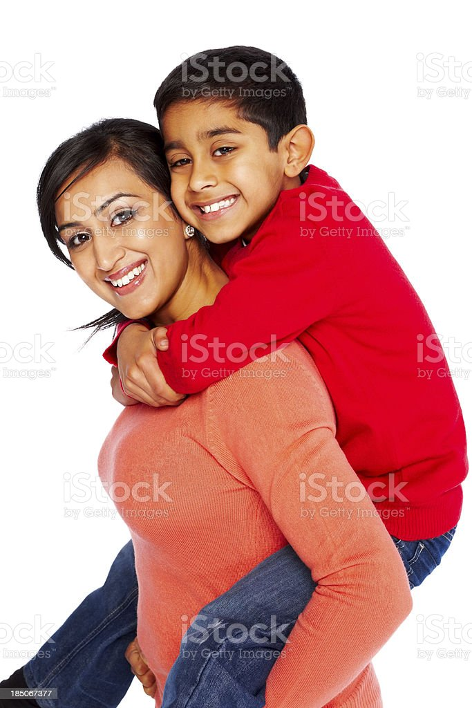 Young woman giving piggyback ride to her son royalty-free stock photo