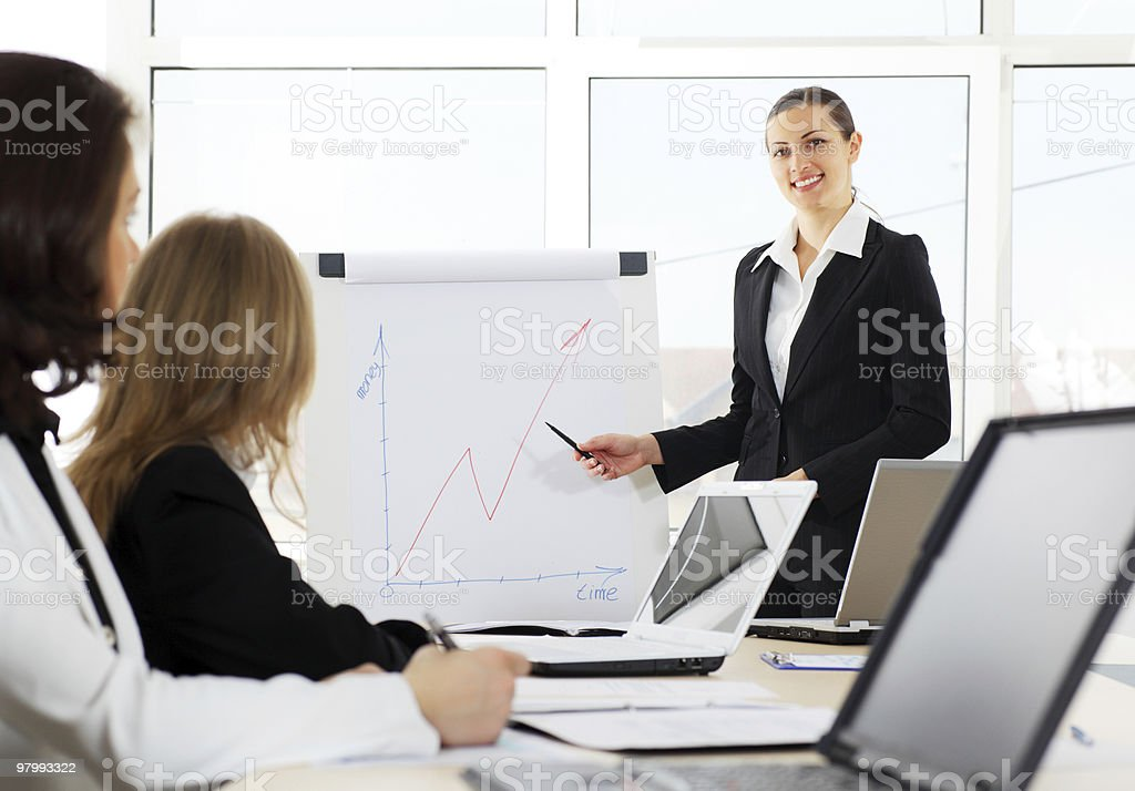 Young woman giving presentation on a flipchart. royalty-free stock photo