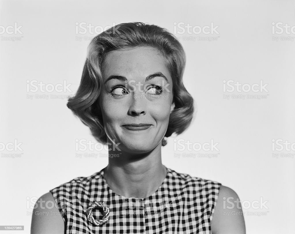 Young woman glancing sideways, smiling stock photo