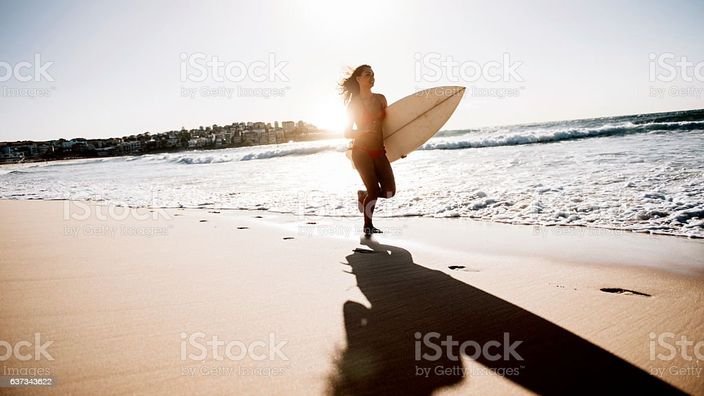 Young woman going for a surf stock photo