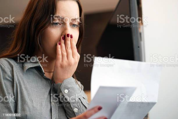 Young woman got a bad letter uvolnenii picture id1183918002?b=1&k=6&m=1183918002&s=612x612&h=k xzdemwm8hdk804stqqodqx9qad6kfe5njvuy4lyeg=