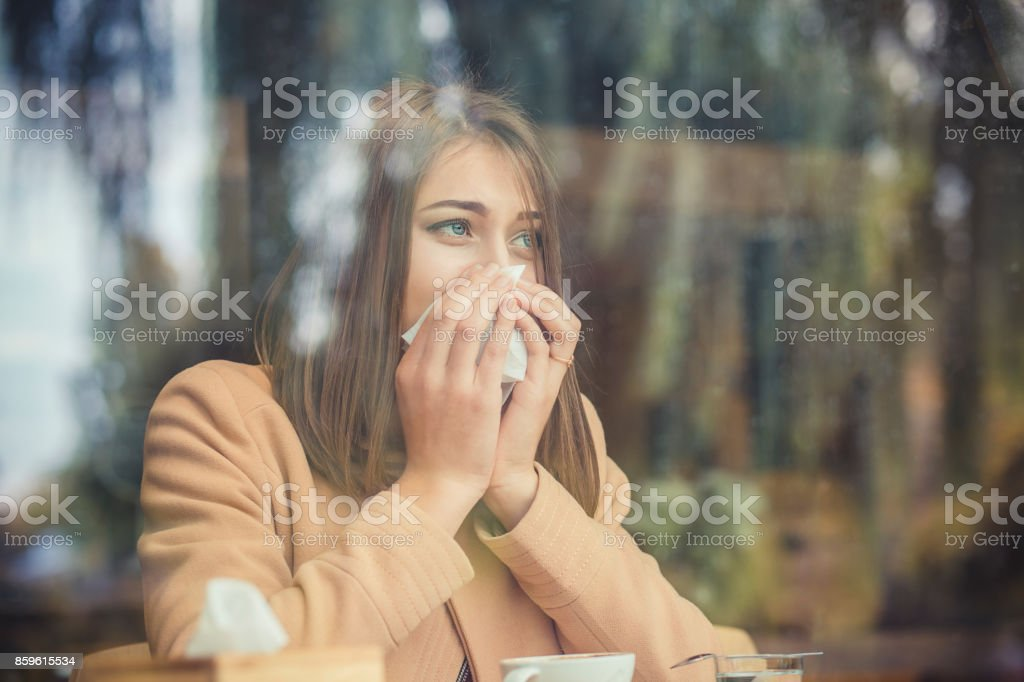 Young woman got nose allergy, flu sneezing nose stock photo
