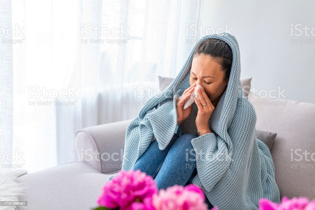 Woman sneeze on bed. Flu. Young woman got nose allergy, flu sneezing...