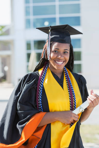 Young woman graduating from high school or university stock photo