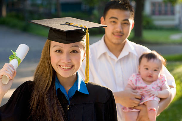 Young woman graduating stock photo