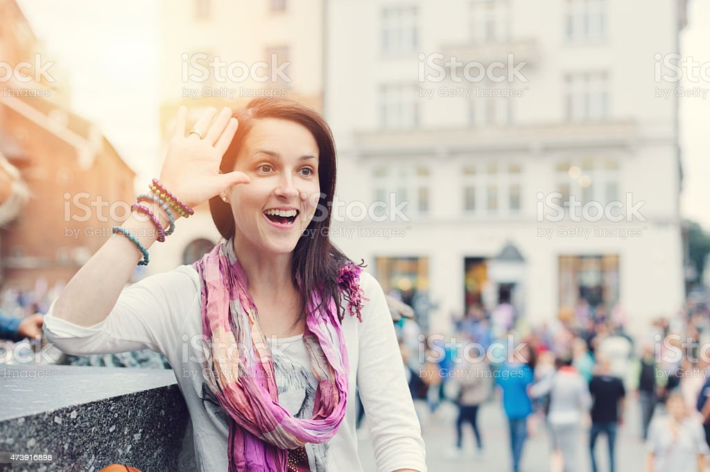 Young woman greeting with hand stock photo