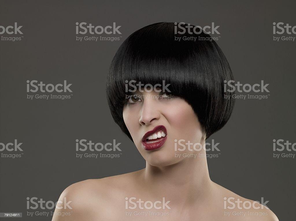 젊은 여자 찡그린 얼굴 포함 royalty-free 스톡 사진