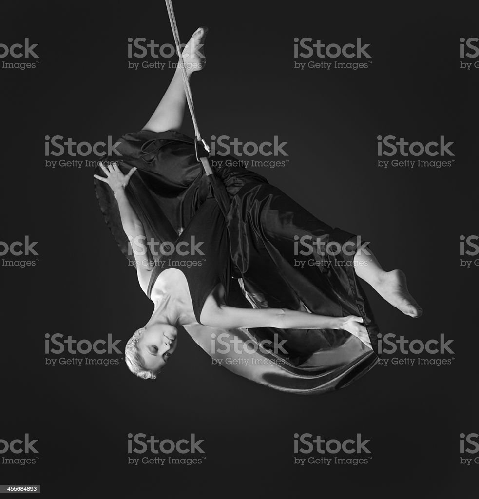 Young woman gymnast on rope stock photo