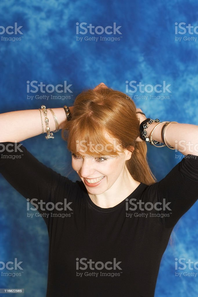 young woman hairstyling royalty-free stock photo