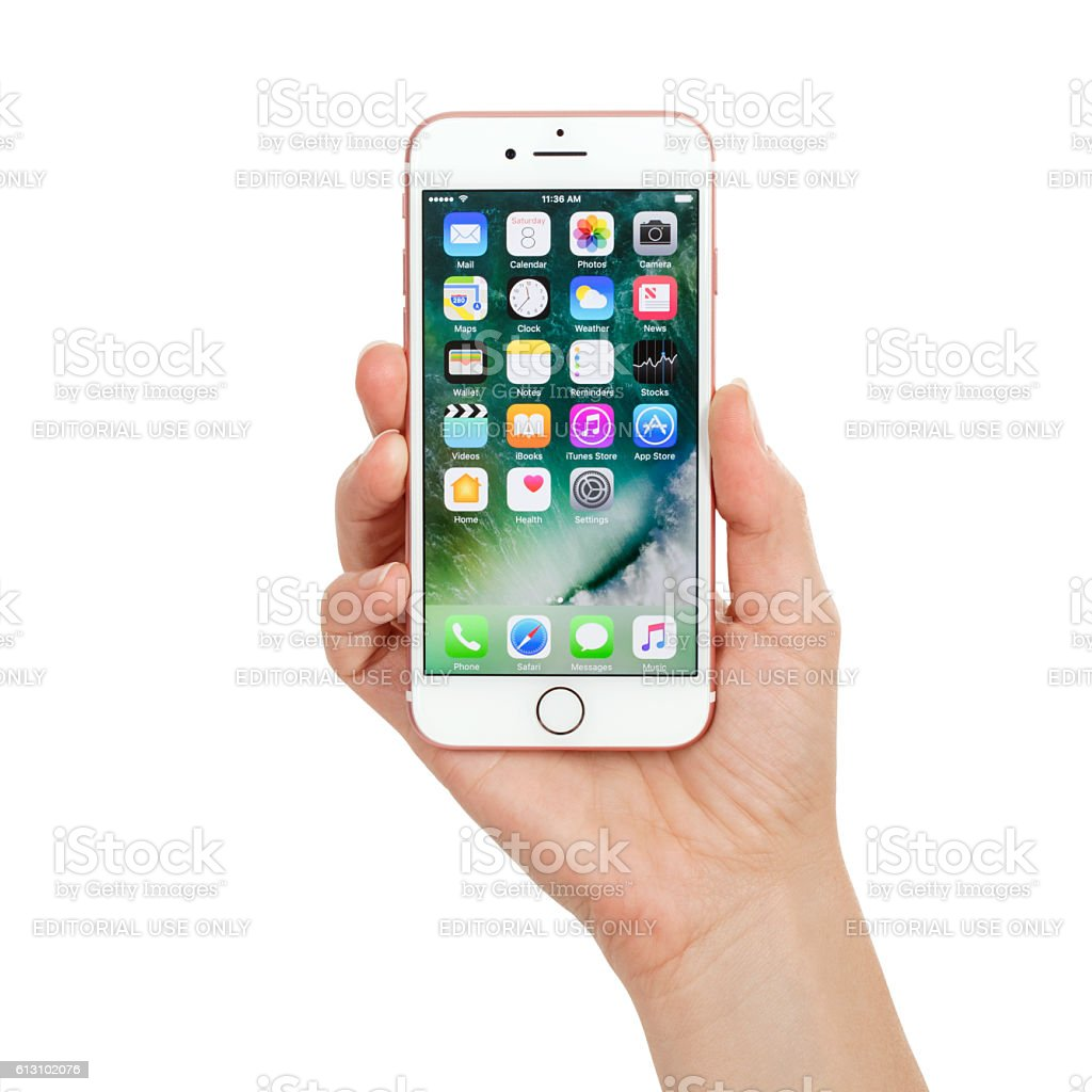 young woman hand holding apple iphone 7 rose gold stock. Black Bedroom Furniture Sets. Home Design Ideas