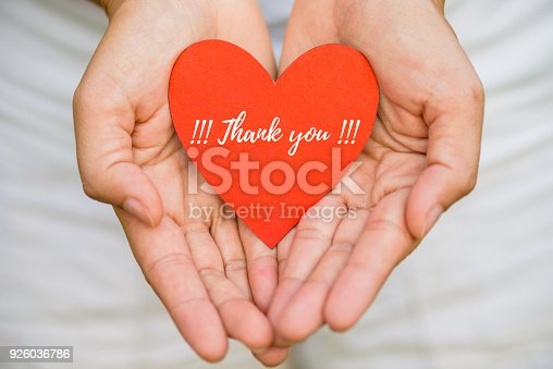 istock Young woman hand holding red heart paper with THANK YOU message. Thankful concept. 926036786