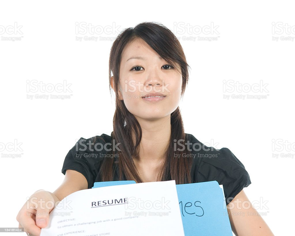 Young woman handing over her resume on a white background stock photo