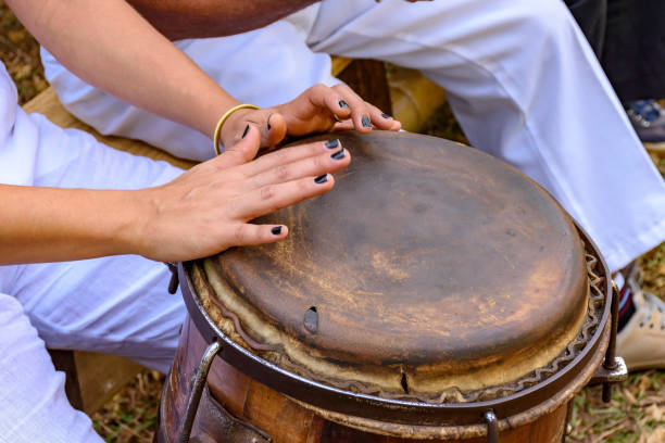 Young woman hands playing drum stock photo