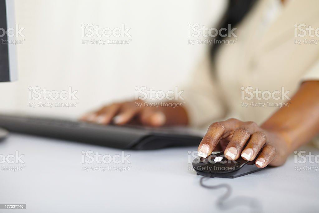 Young woman hands working on computer stock photo