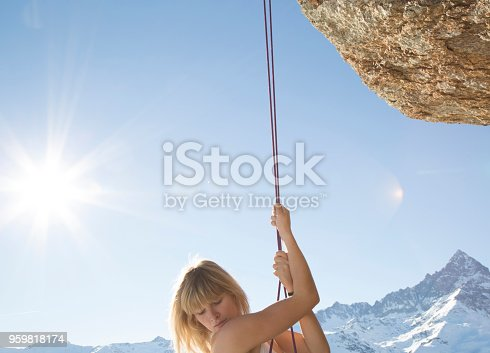 A mountain peak and sun are behind her, Piedmont