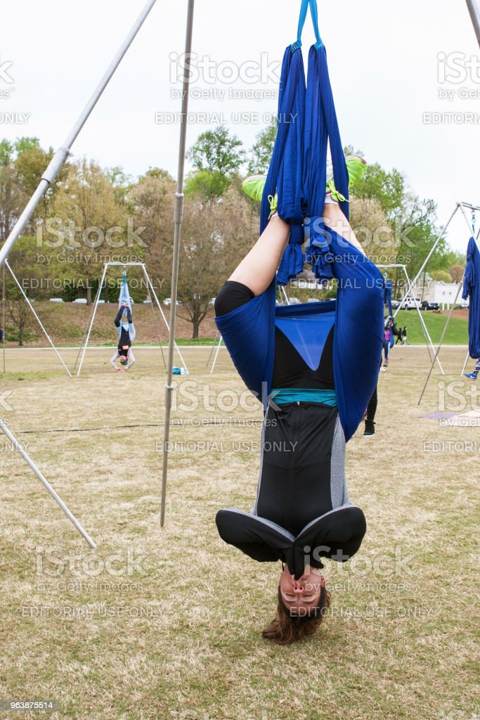 Young Woman Hangs Upside Down In Atlanta Aerial Yoga Class - Royalty-free Adult Stock Photo