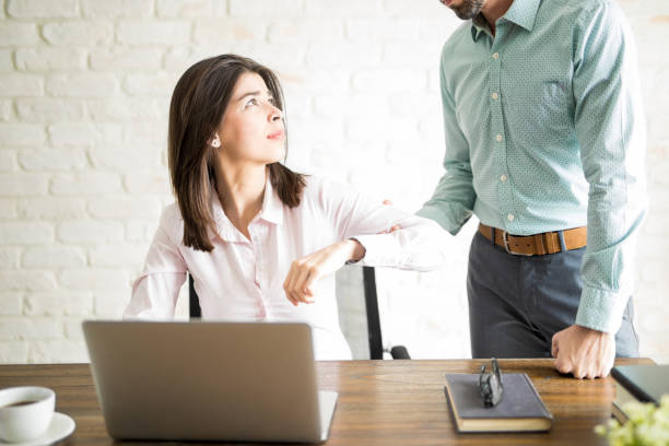 Young woman harassed by her boss stock photo